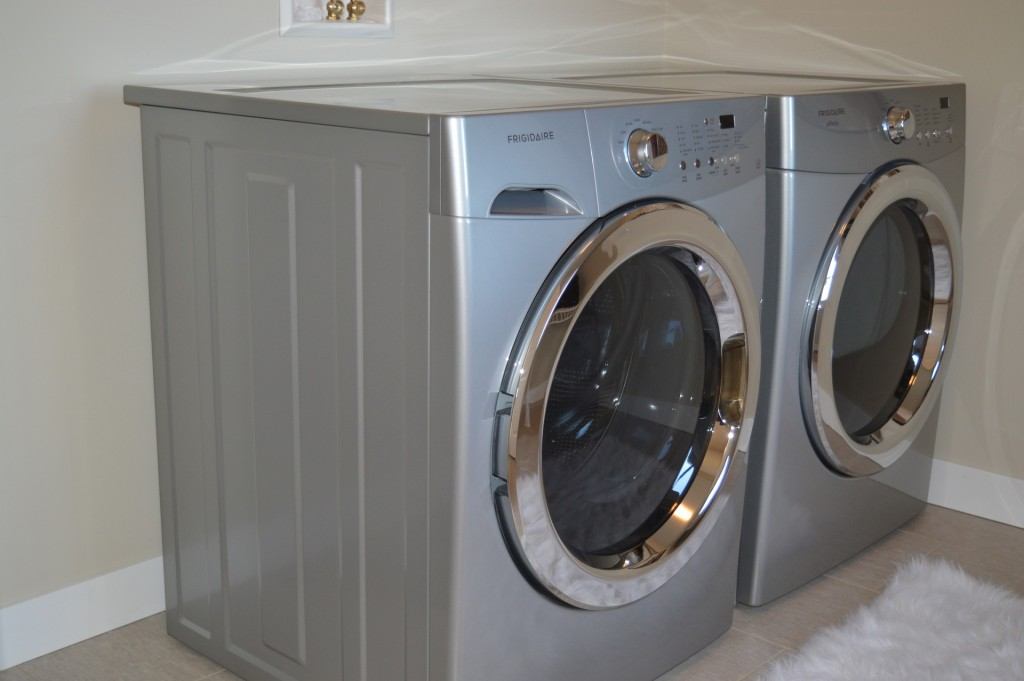A front-load washing machine and dryer pair.